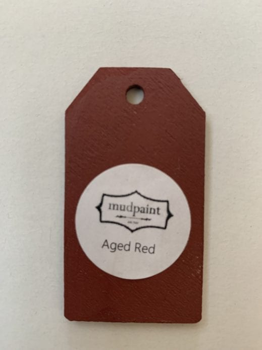 Small wooden tag hand painted with red paint