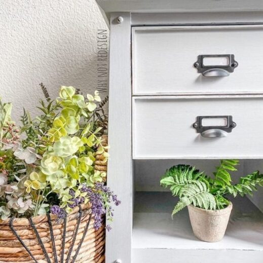 A night stand with plants and painted in a light gray clay furniture paint