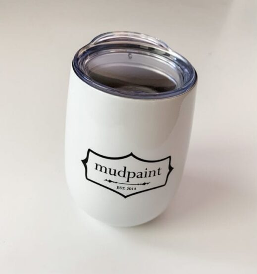 mudpaint branded coffee cup tumbler sitting on a white backdrop